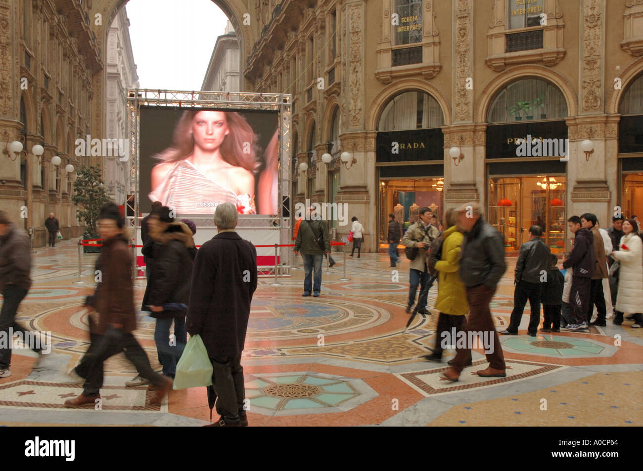 A giant TV screen graces the centre of the Galleria Vittorio Emanuele in Milan during Fashion Week February 2005 - Stock Image
