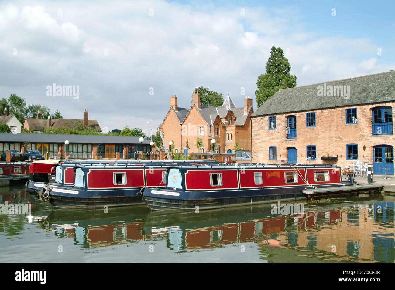 Boats moored in the canal basin at Market Harborough Leicestershire England - Stock Image