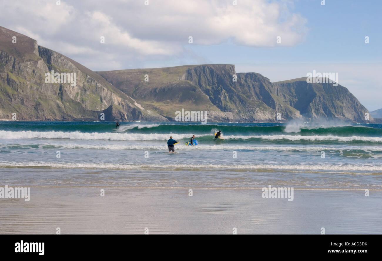 Ireland County Mayo Achill Island Keel Beach view toward Dooega Head surfers an boogie boarders - Stock Image