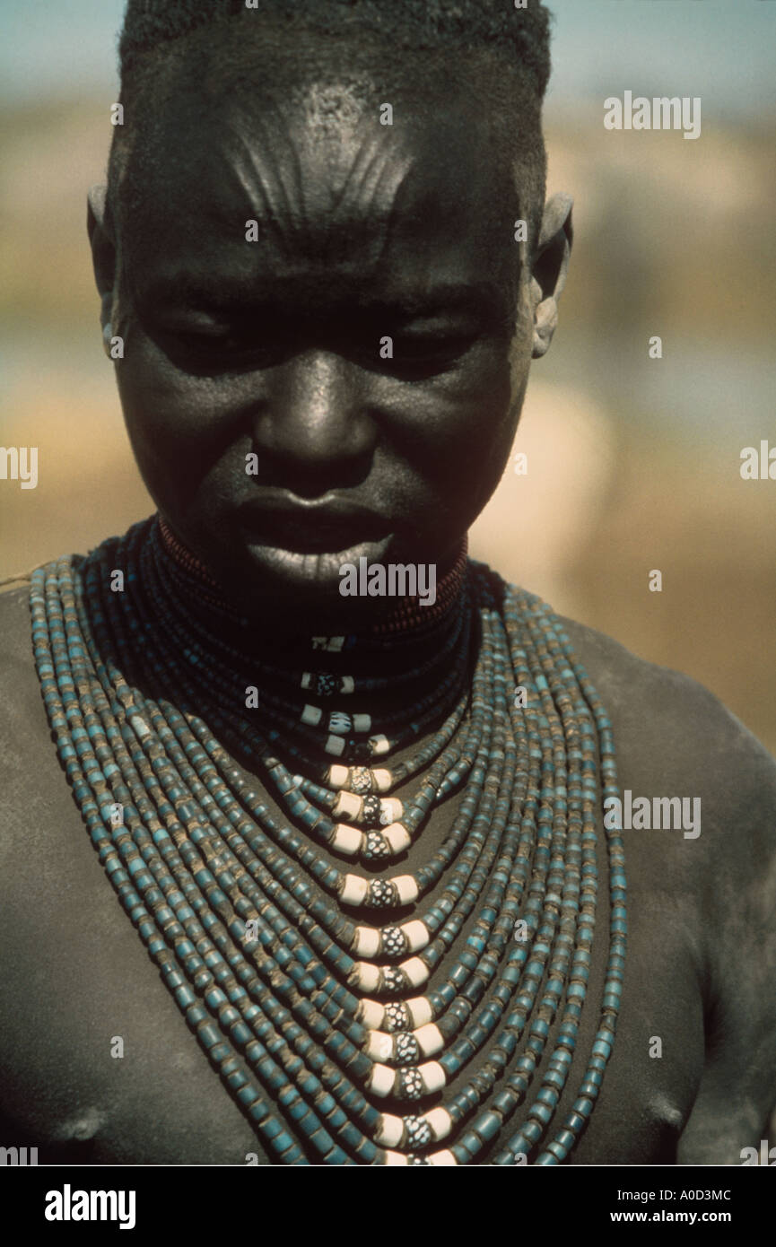 Dinka Bride wears venetian glass beads. Sudan - Stock Image