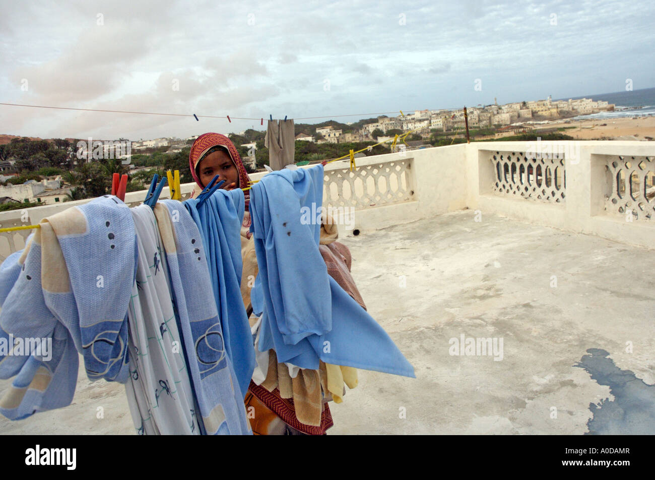 A Somali woman drying clothes in Mogadishu, Somalia Stock Photo