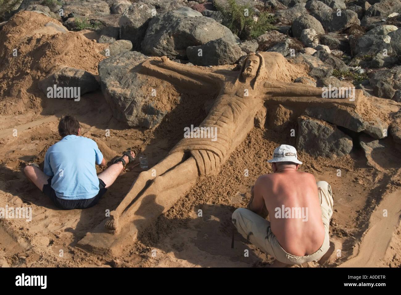 Sand sculptors working - Stock Image