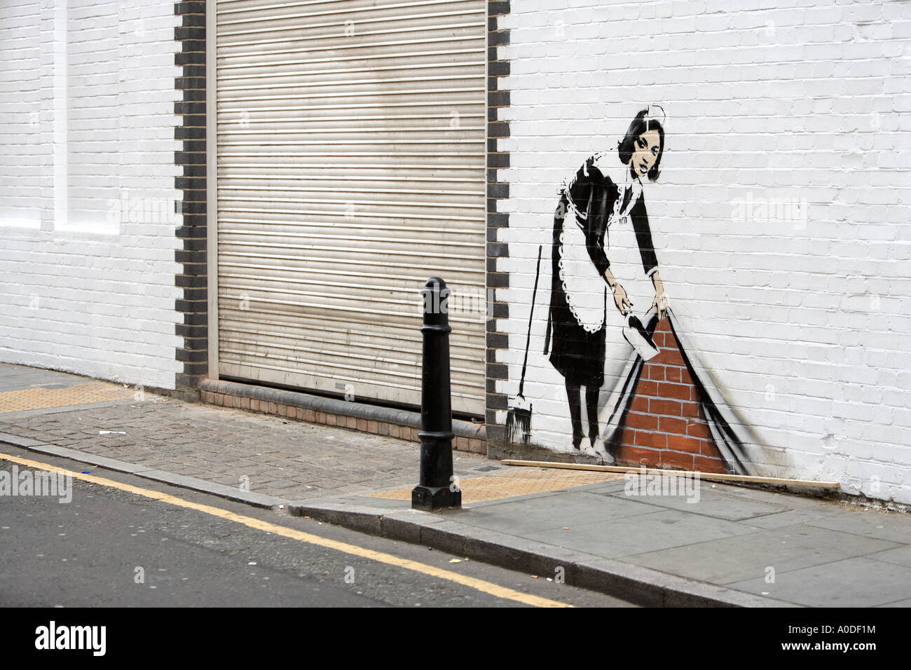 Street art by the atrist Banksy in Camden London 2006 Titled Chambermaid - Stock Image