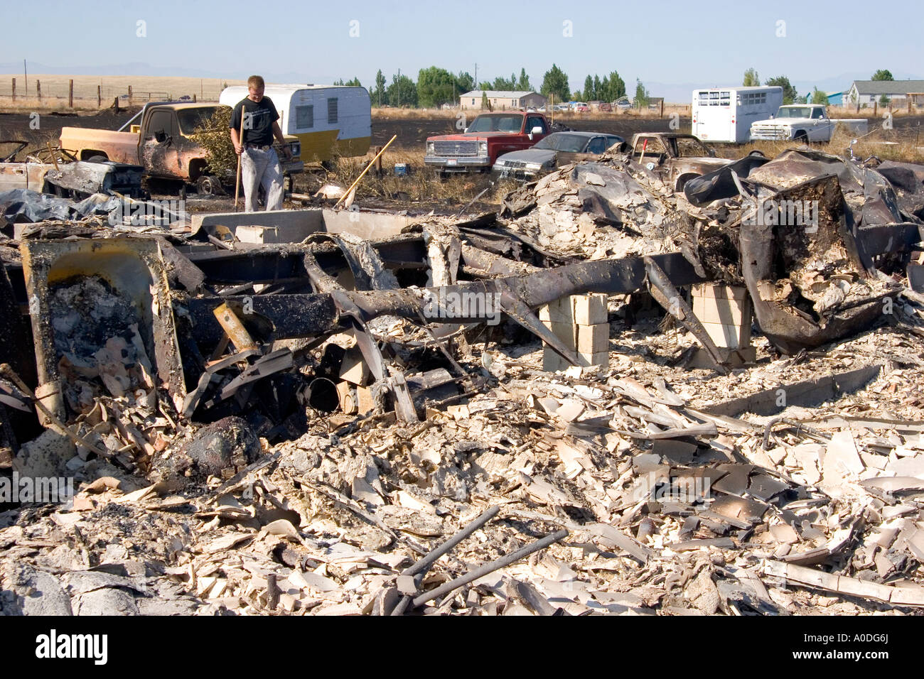 Victims sift through the rubble of a home destroyed by wildfire near Mountain Home Idaho Stock Photo