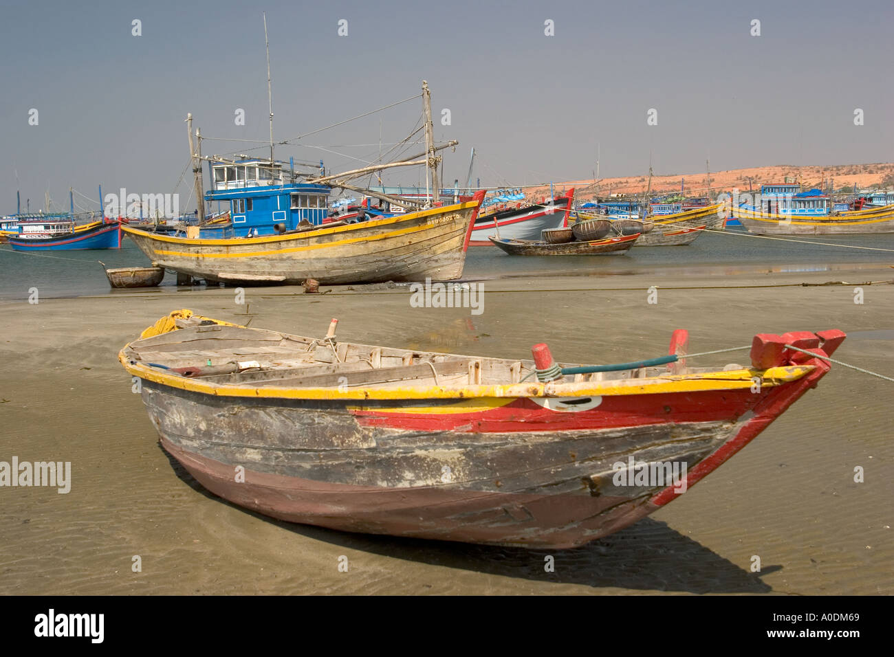 Vietnam Mui Ne fishing village small boat with painted eye at waters edge Stock Photo