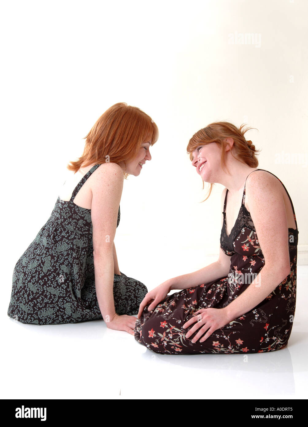 Twin red head sisters - Stock Image