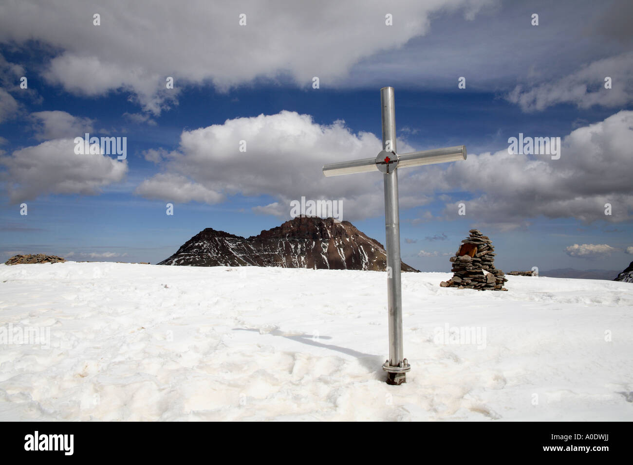 Stone cairn and marker left by resuce teams at first peak on Mount Aragats. Armenia, Southwest Asia - Stock Image