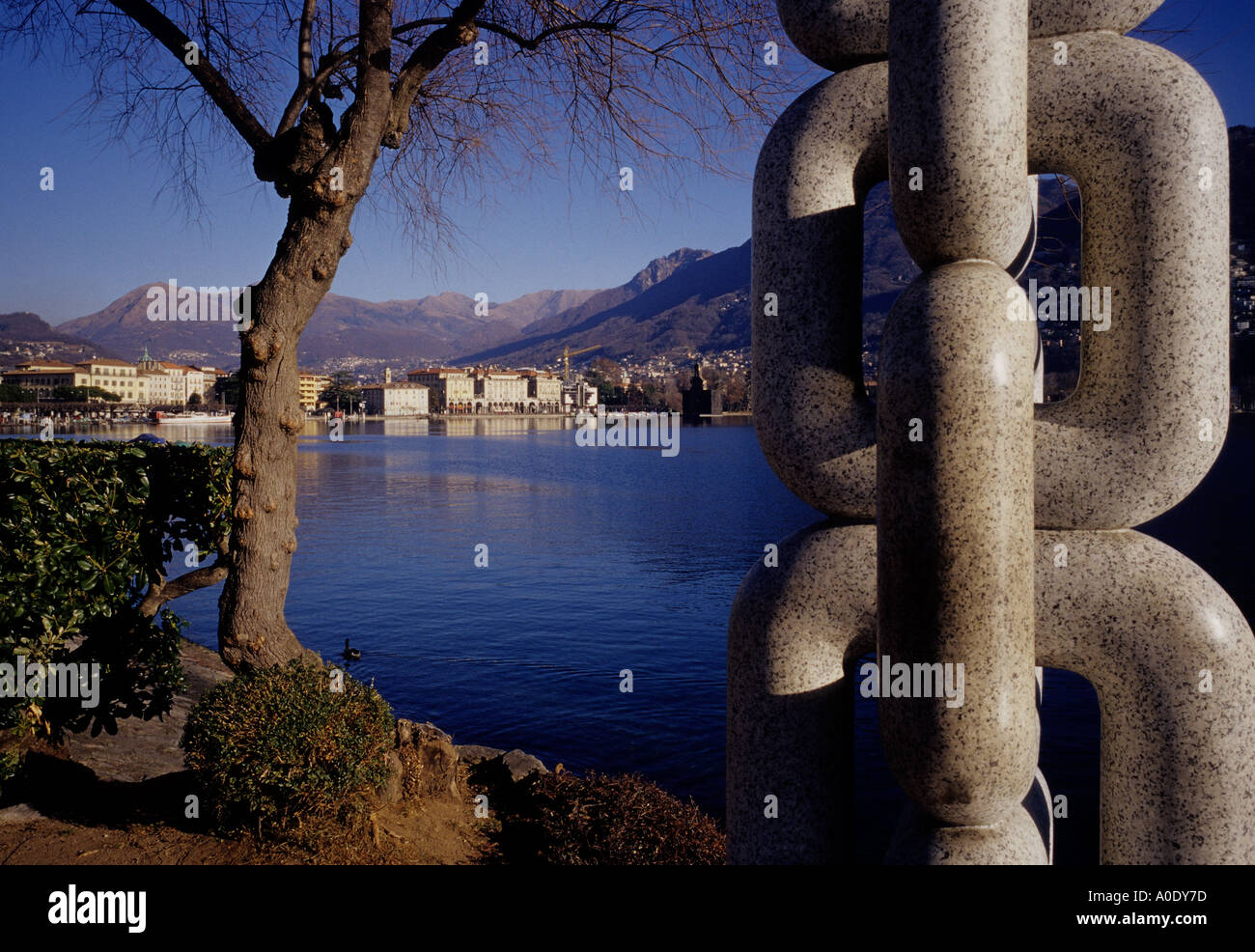a view of the Ceresio lake and the city of Lugano and a sculpture on the right side Switzerland Stock Photo