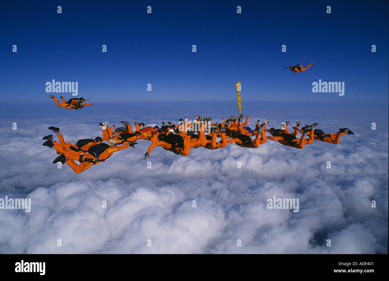 Freefall formation above the clouds - Stock Image