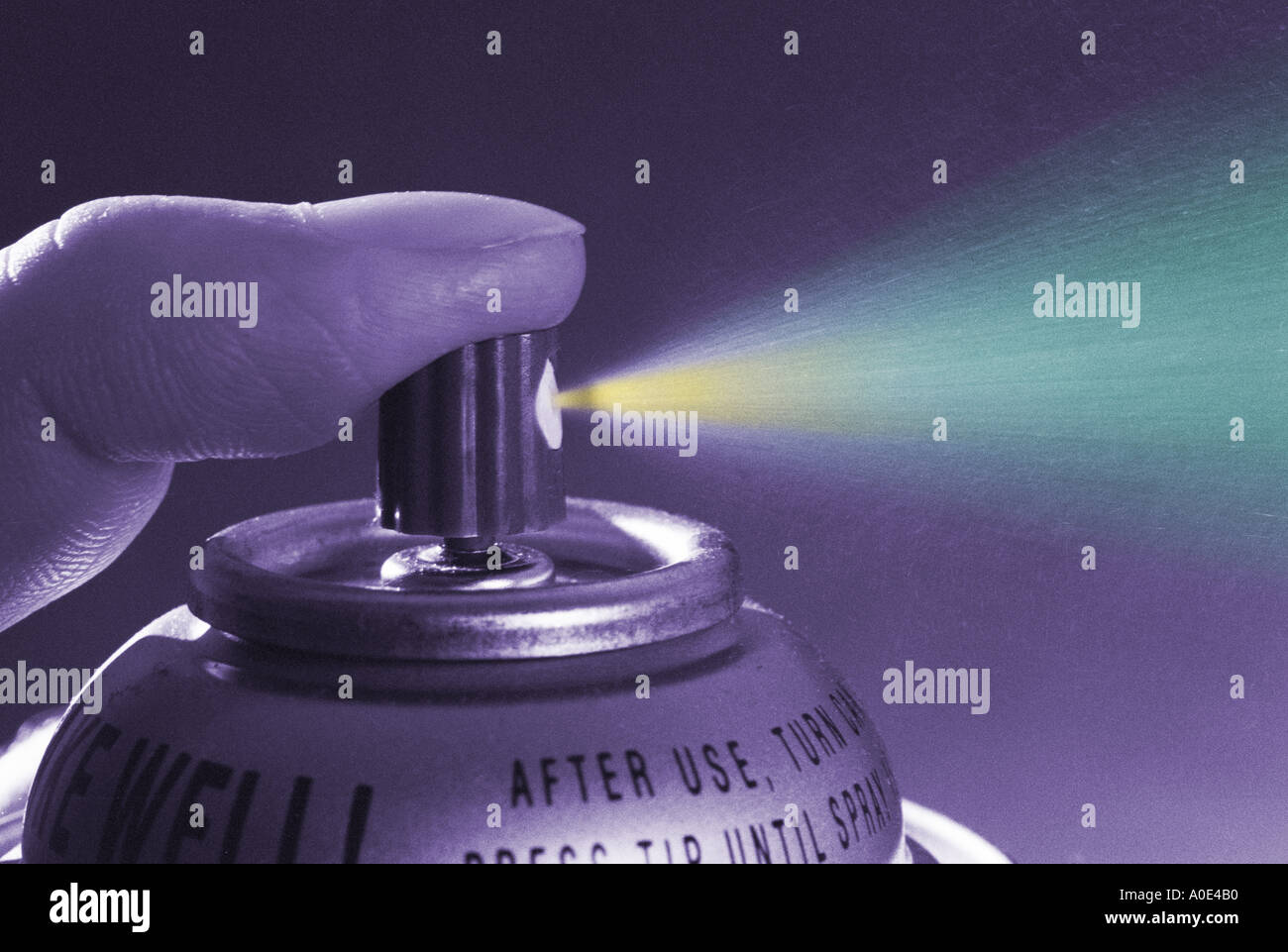 aerosol spray can being used pollution concept - Stock Image