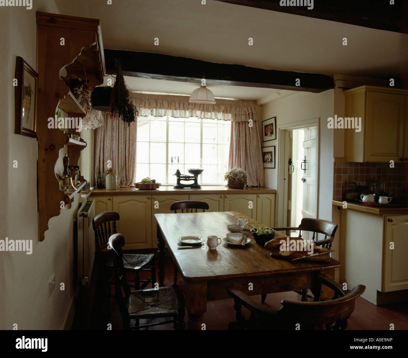 Pine table and chairs in cottage diningroom - Stock Image