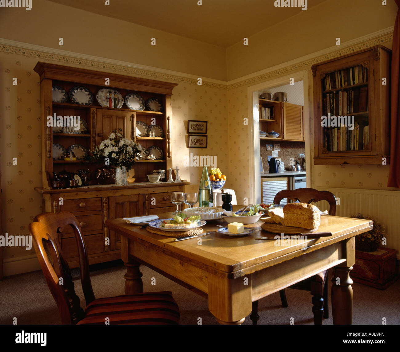 Settings On Pine Table With Dresser In Dining Room Stock Photo Alamy