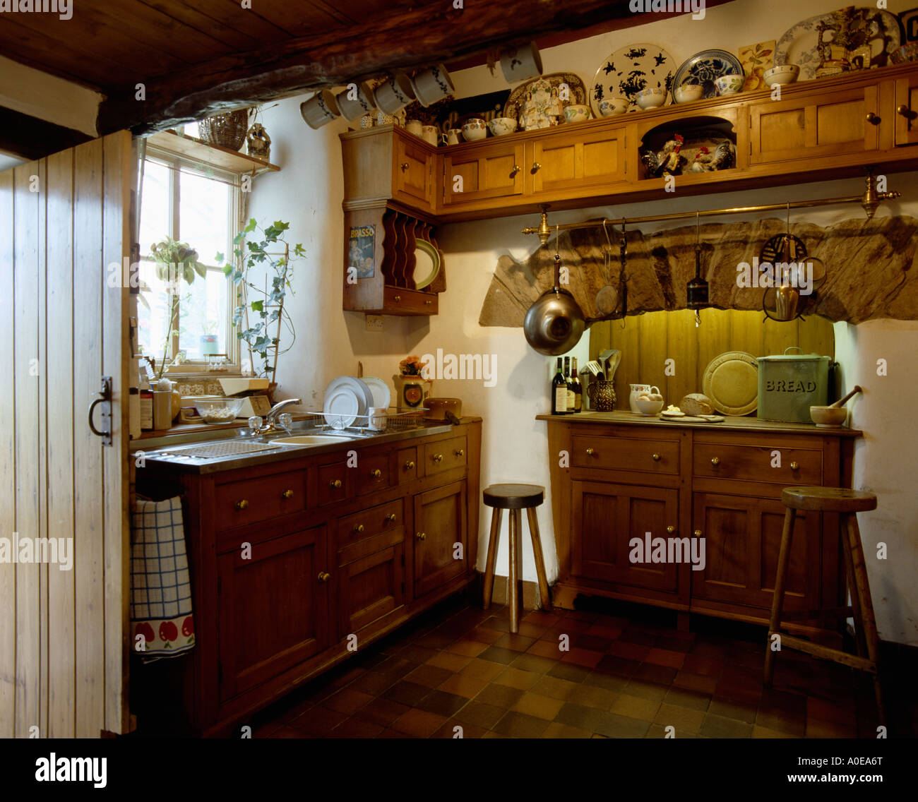 Door Open Into Wooden Cottage Kitchen With Pine Furniture