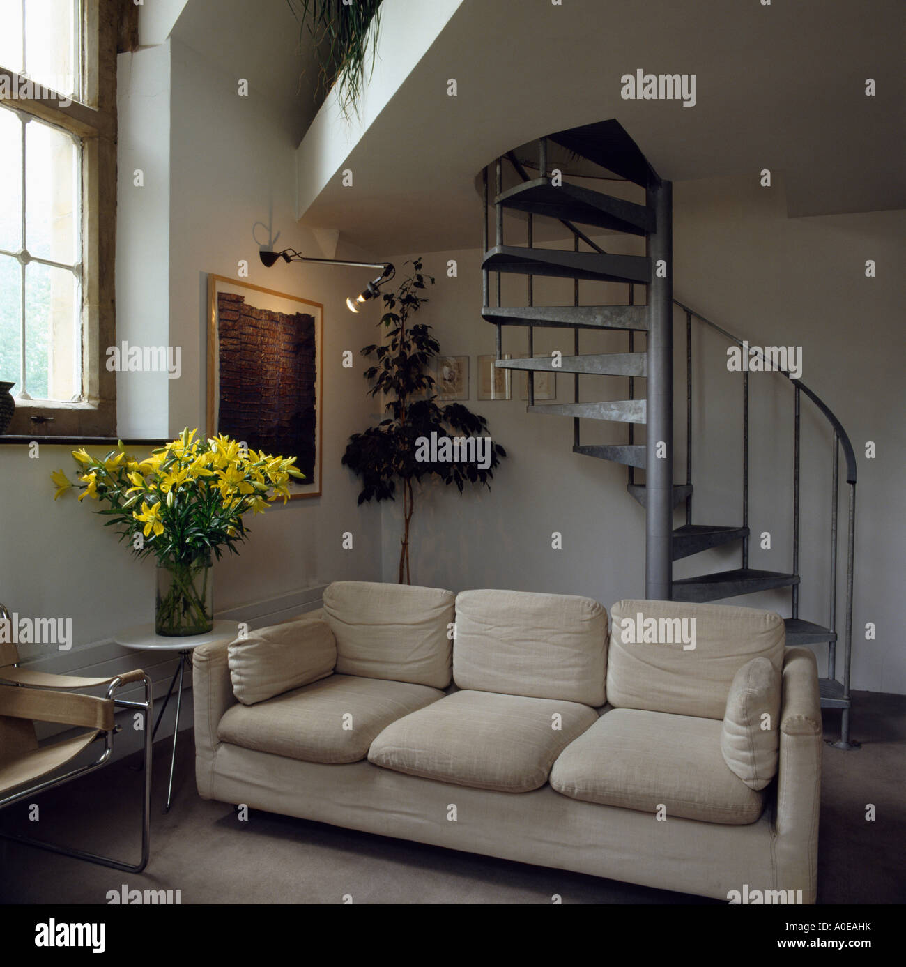 Modern Sofa In Attic Living Room With Spiral Staircase