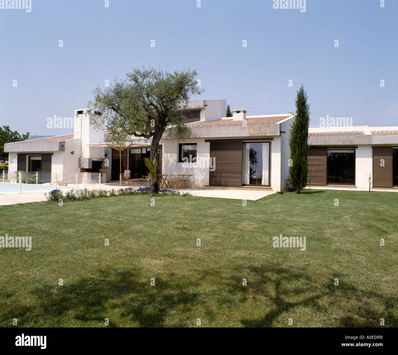 Lawn in front of single storey modern house in provence