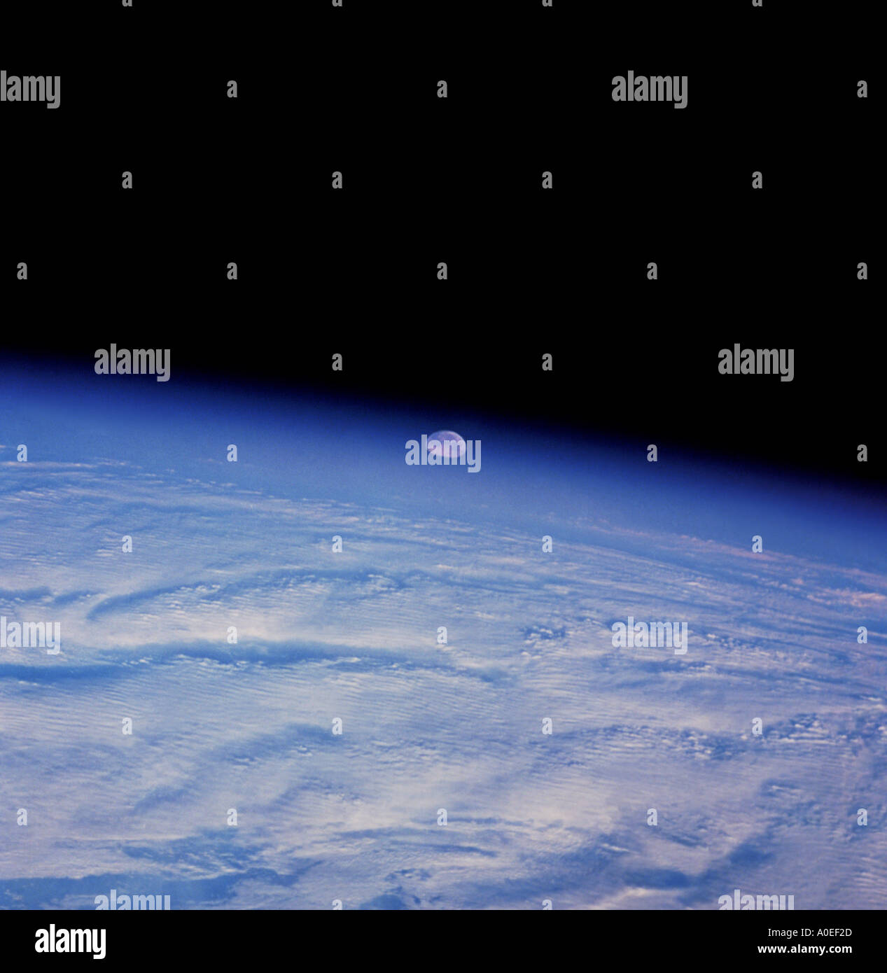 Moonrise from space - Stock Image