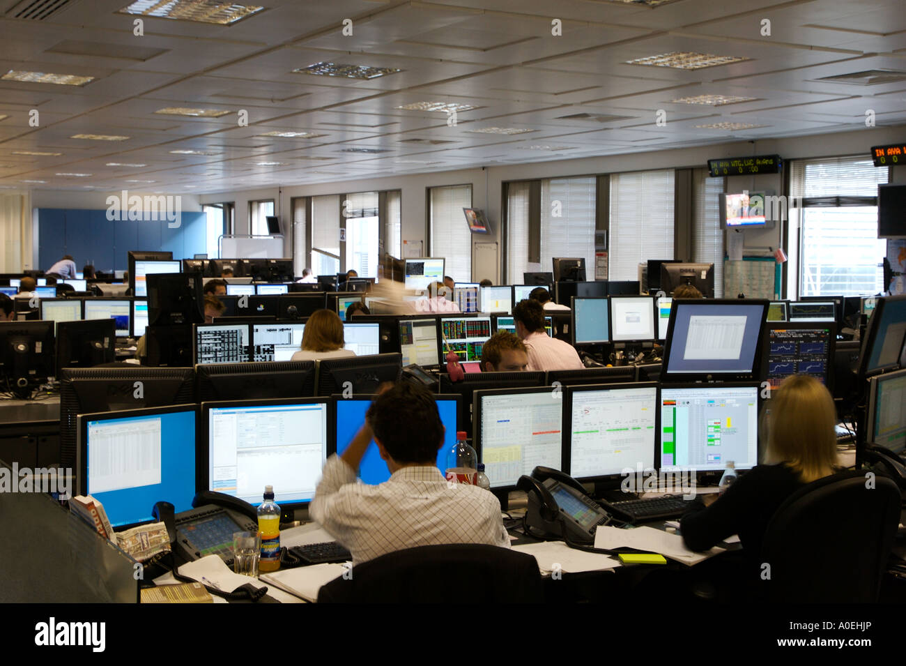 Trading Floor In City Of London Traders Working On