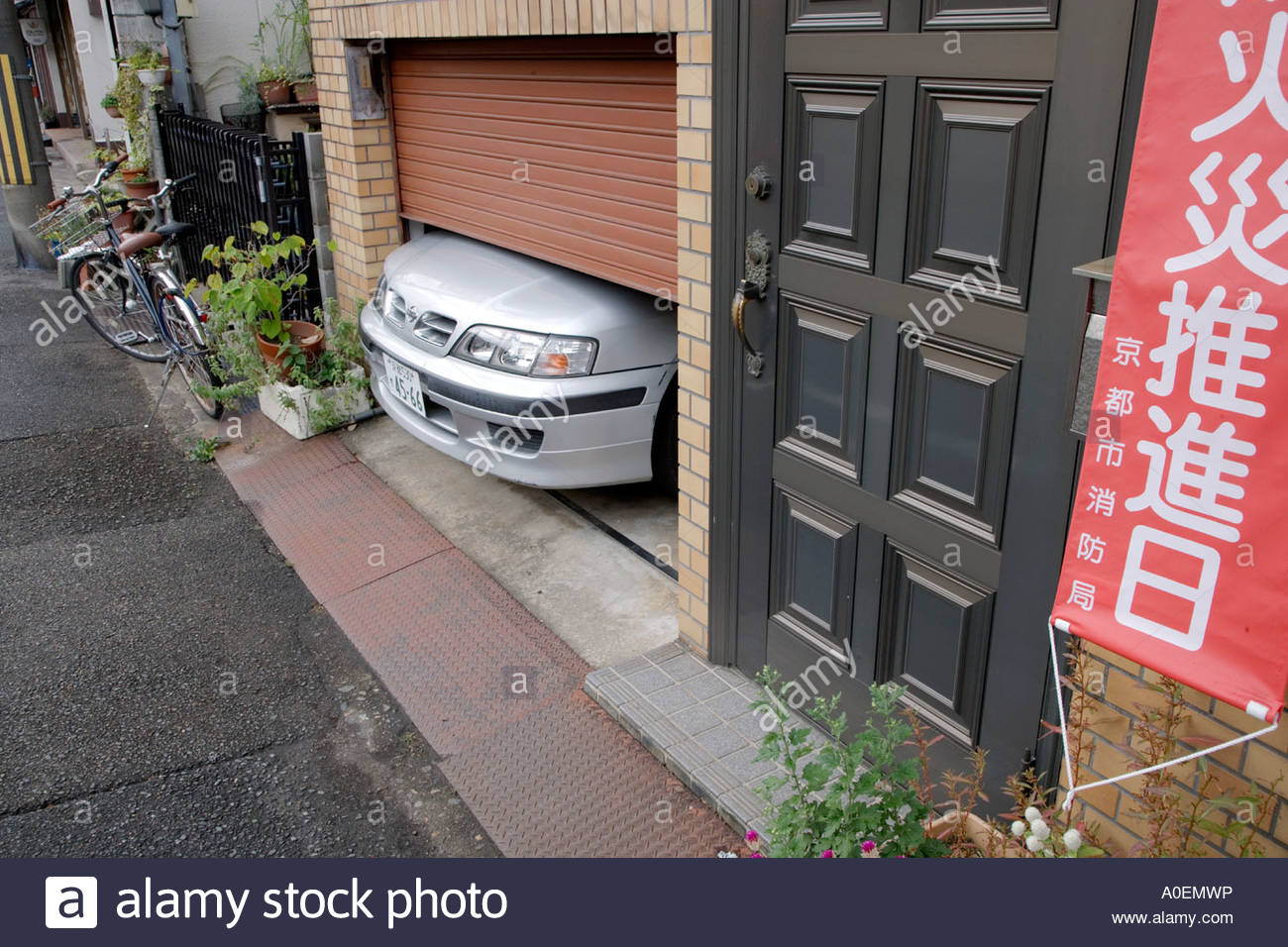 Indoor Parked Car With The Nose Sticking Out As The Garage Is To