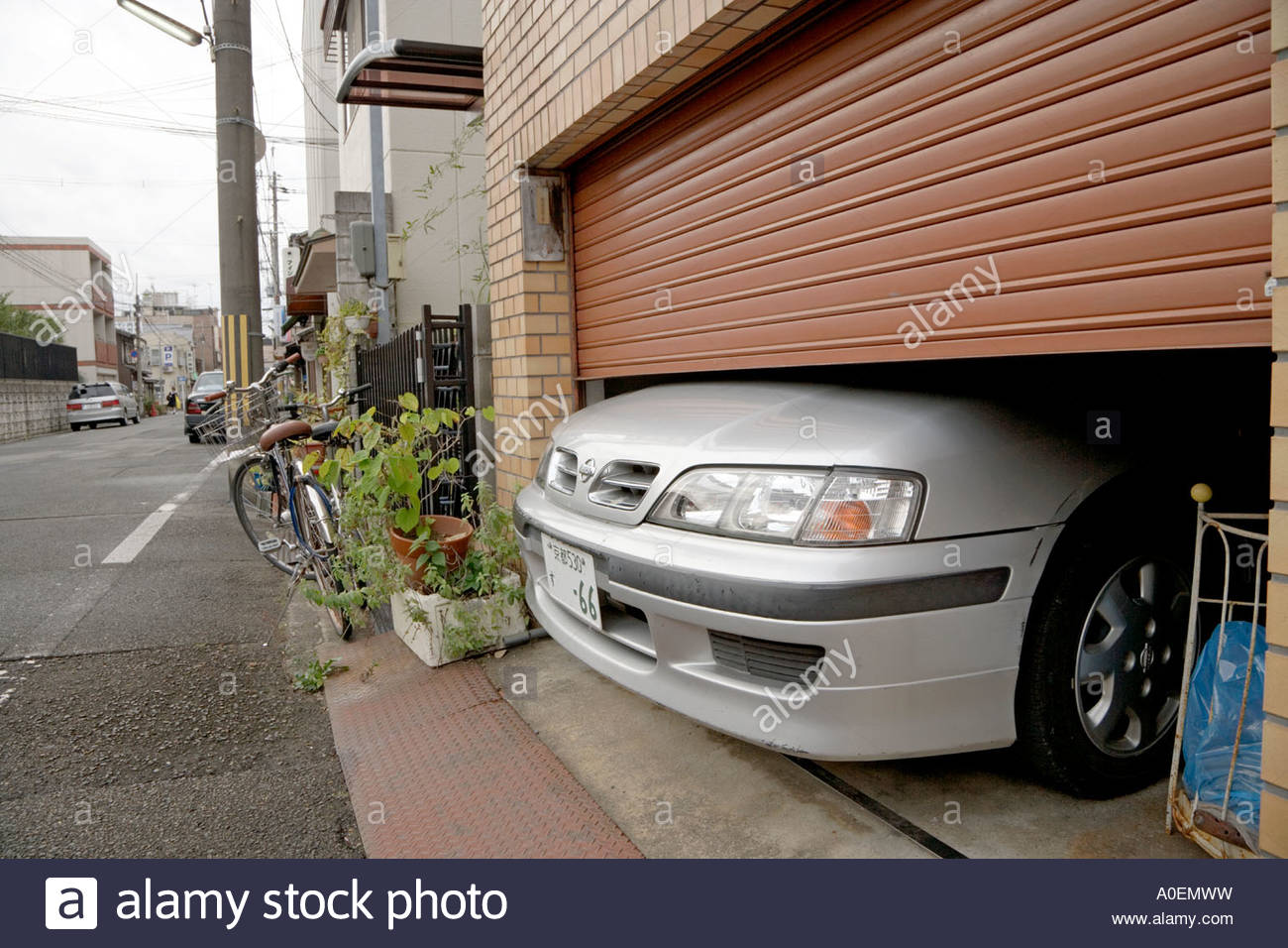Indoor Parked Car With Nose Sticking Out From Under The Door As The