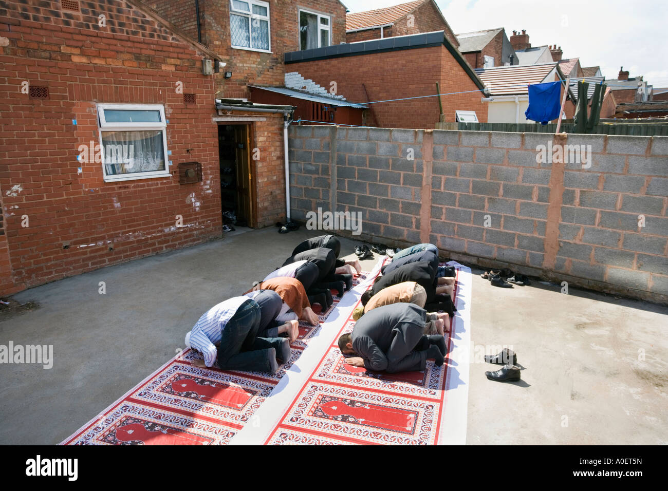 Friday prayers at the Tayyabah Mosque in the Ward End area of Birmingham UK - Stock Image
