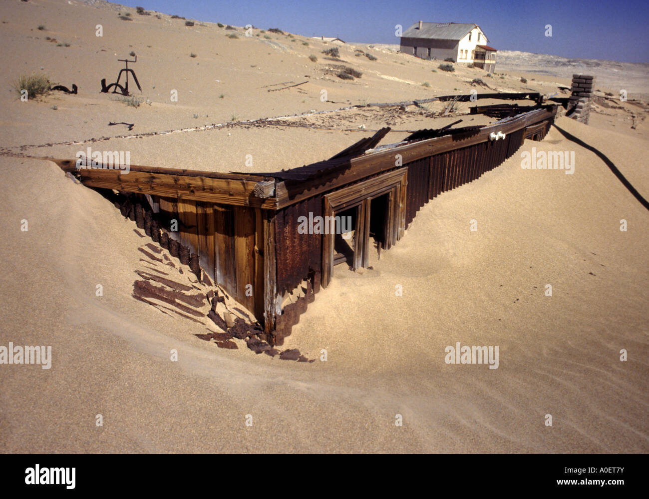 house disappearing under the sands of the Namib Desert in ...