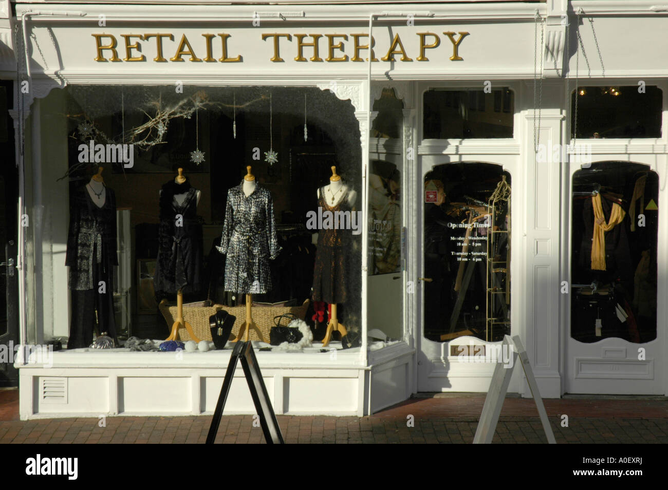 Front of shop called Retail Therapy showing the name - Stock Image