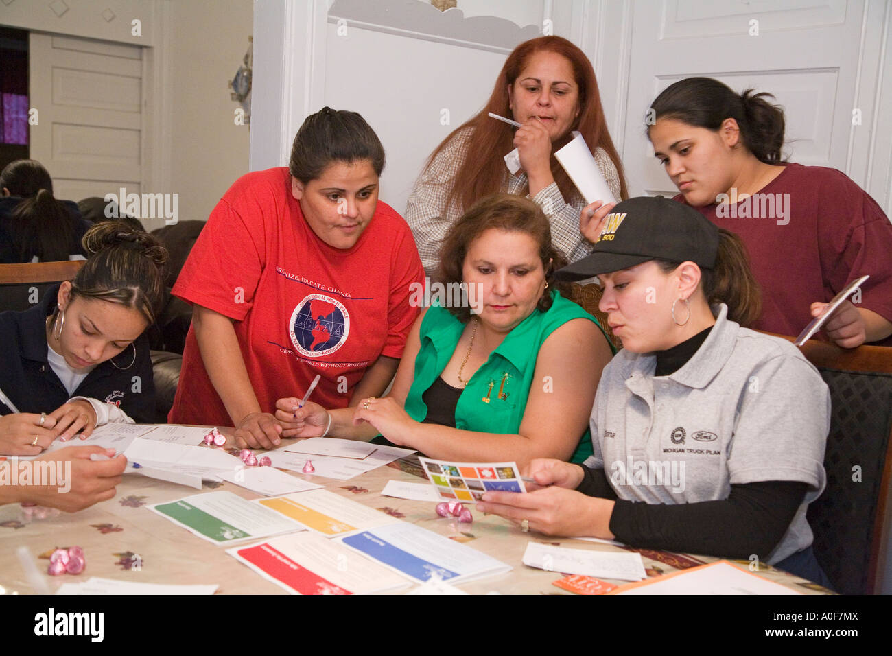 Women Write Postcards Urging People to Vote - Stock Image
