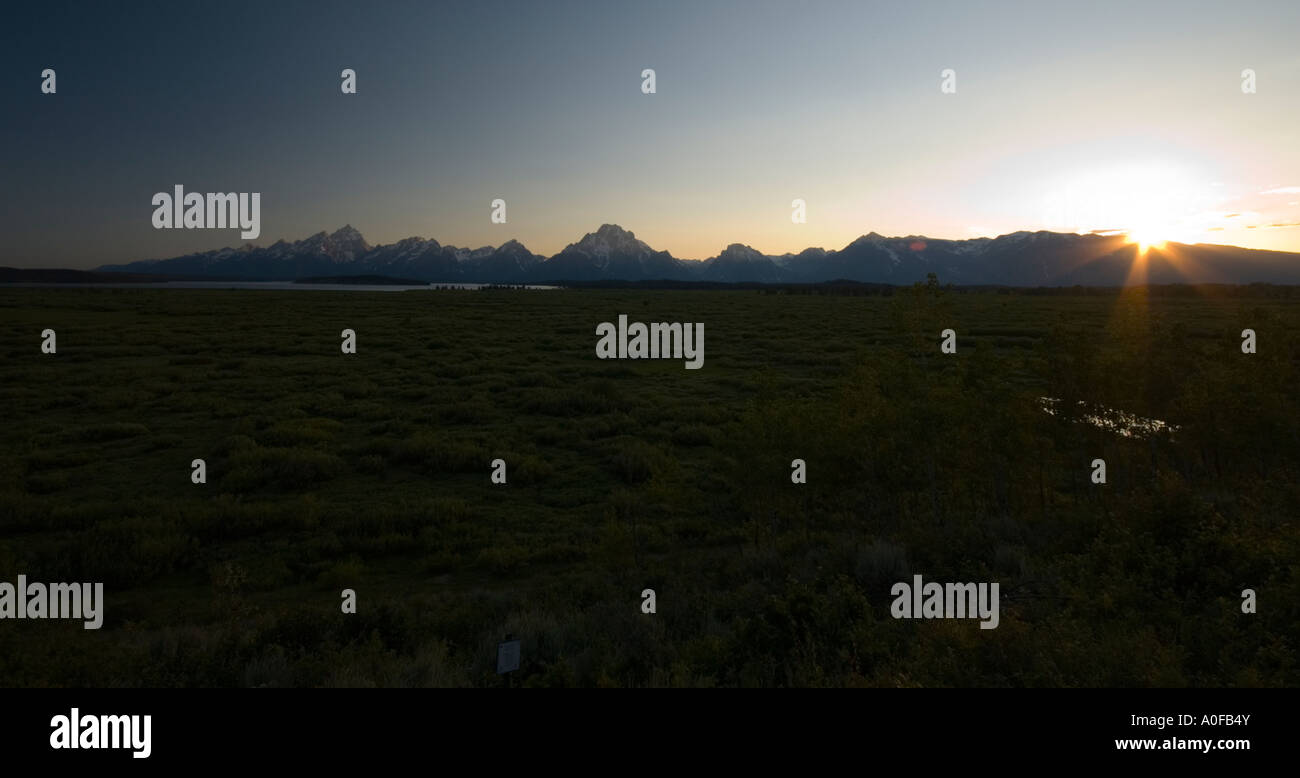 Silhouetted mountain range Grand Teton at sunset from the