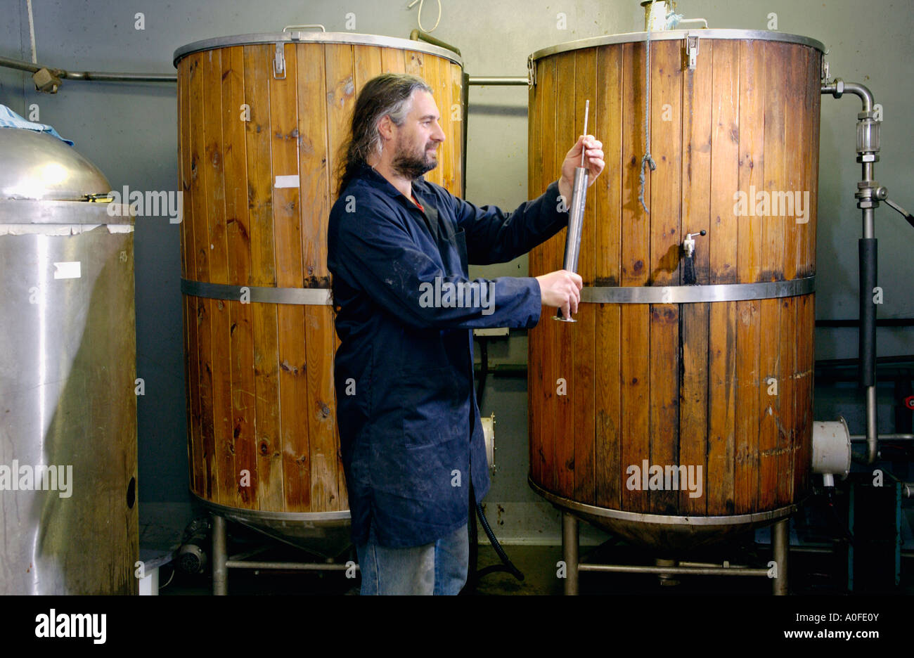 Brewer Chris Gooch in the Teme Valley Brewery behind The Talbot at Knightwick Worcestershire England UK - Stock Image