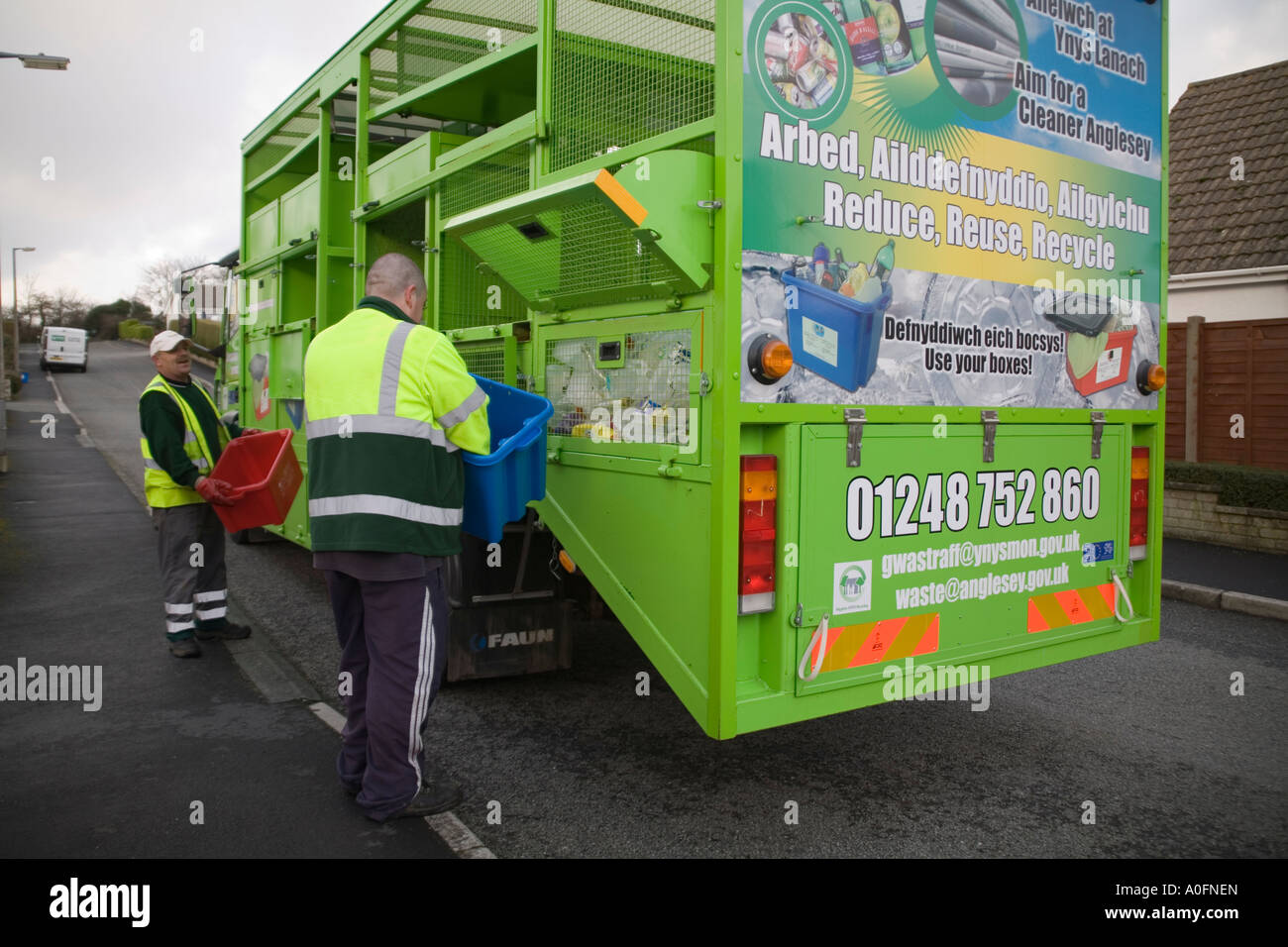 ANGLESEY NORTH WALES UK December Two men collecting household recycled items - Stock Image