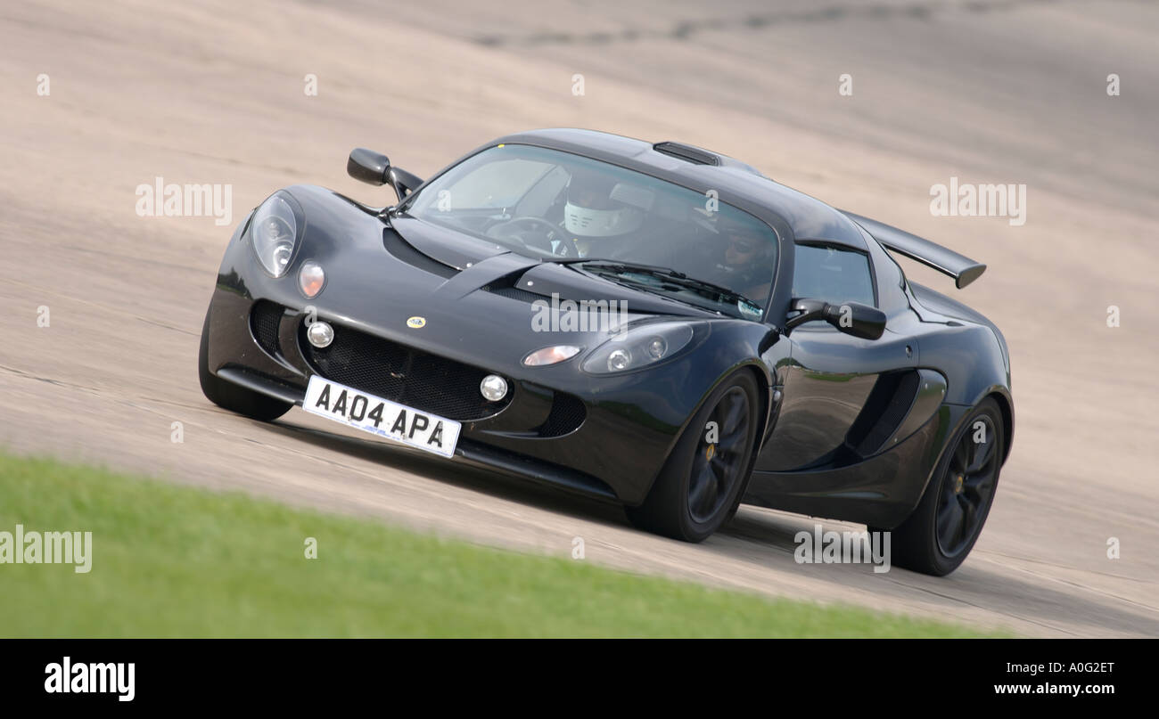 Black Lotus Exige Sports Car Racing On A Race Track In The Uk   Stock Image