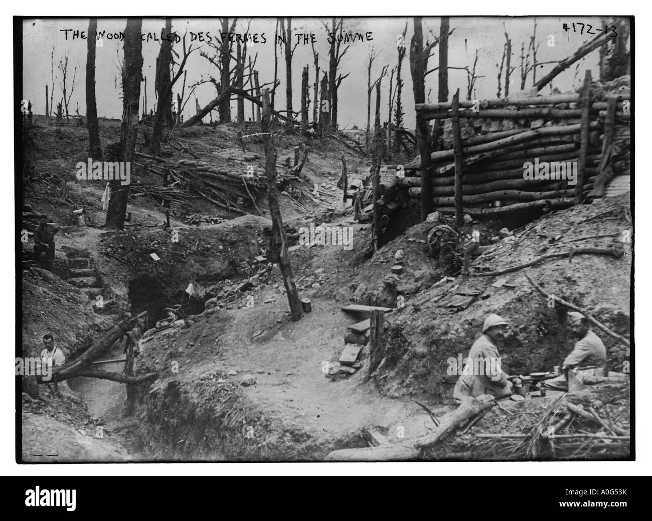 The Wood called Des Fermes in the Somme France Soldiers in World War I trench with trees decimated from battle - Stock Image