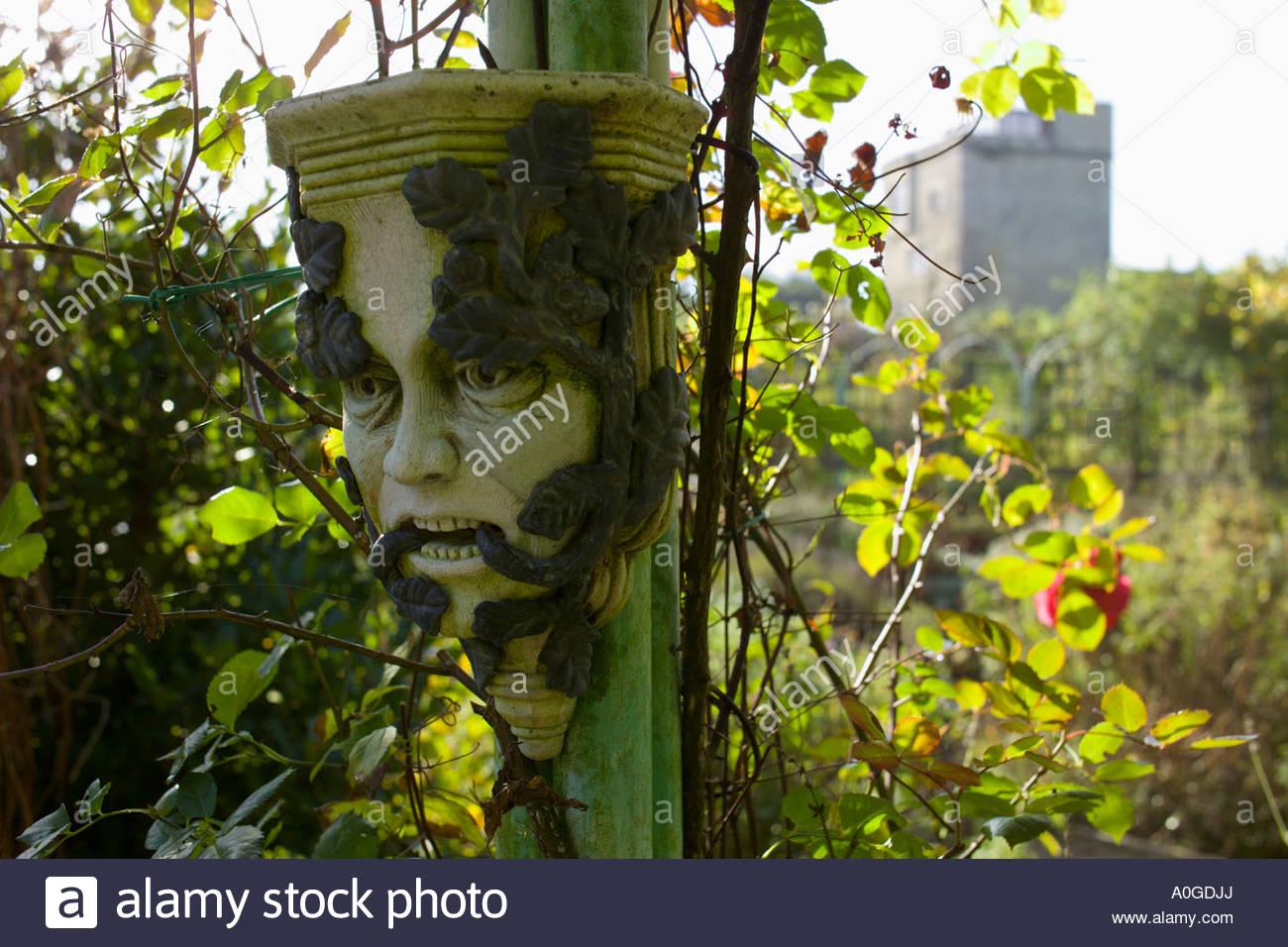 The Abbey House Malmesbury Wiltshire UK Pollard Autumn In Large Garden Pagan  Masks As Ornament