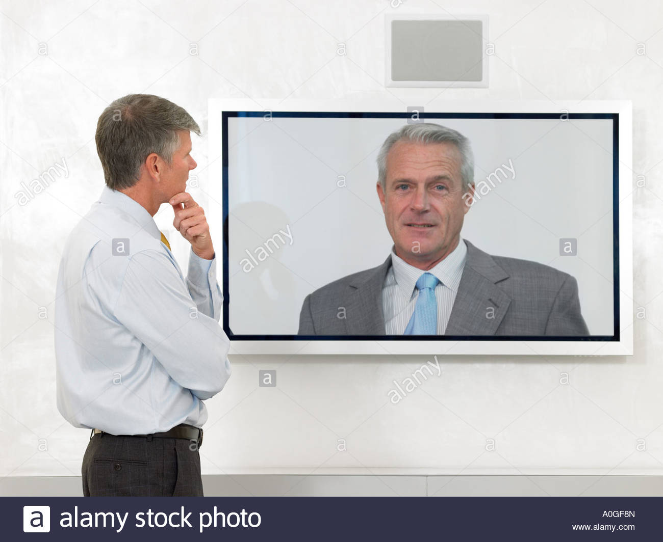 Businessmen in video conference - Stock Image