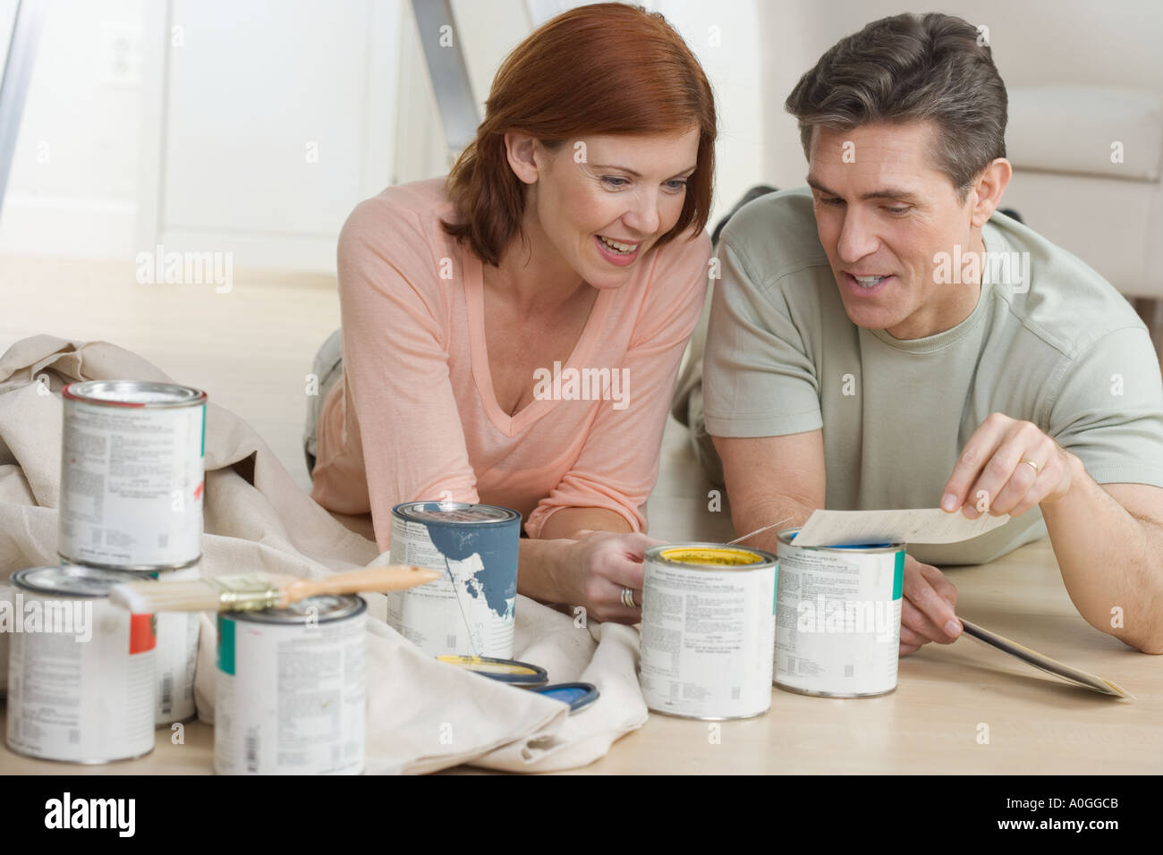 Couple discussing paint color choices - Stock Image