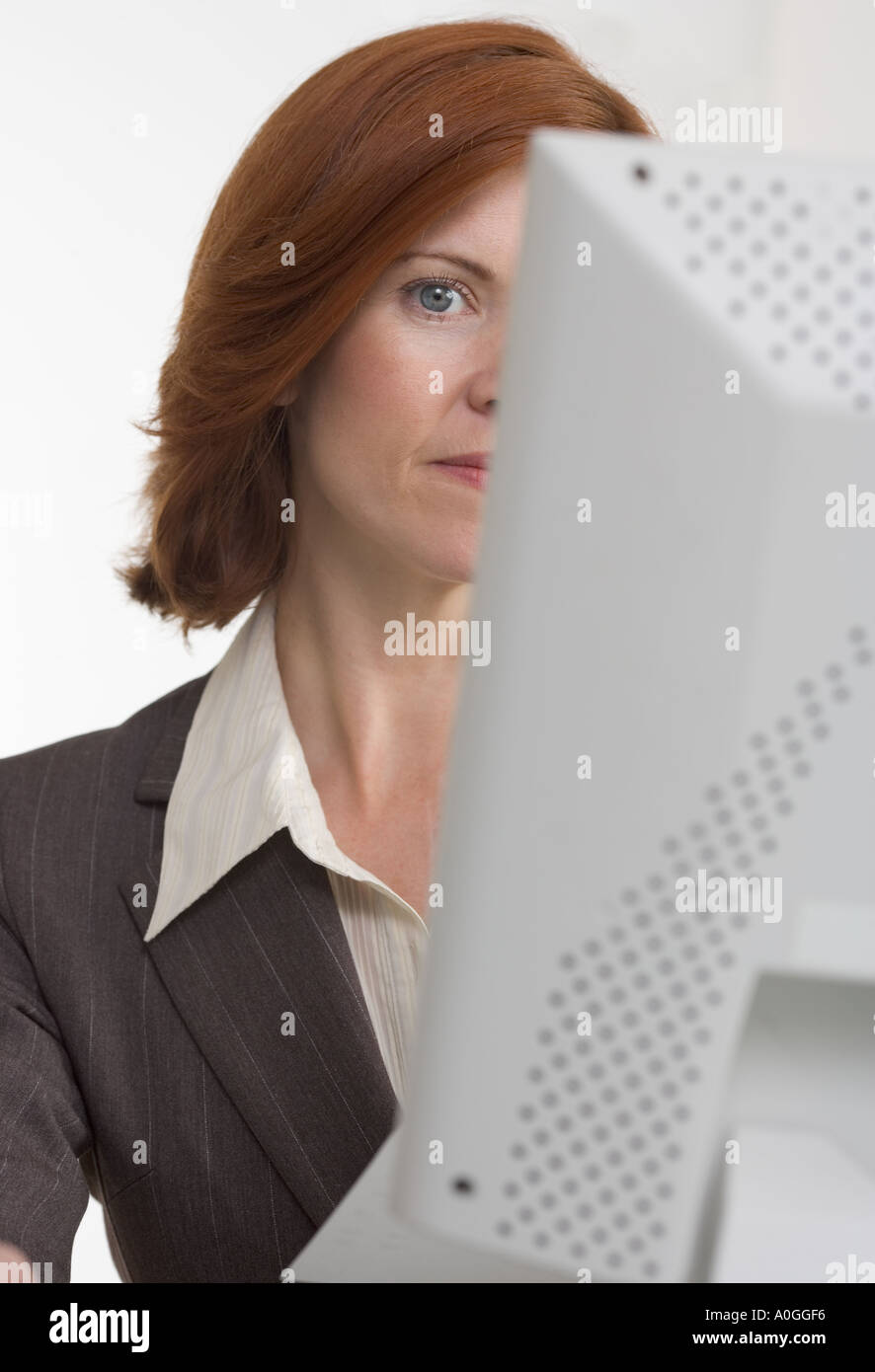 Businesswoman with face hidden by computer - Stock Image