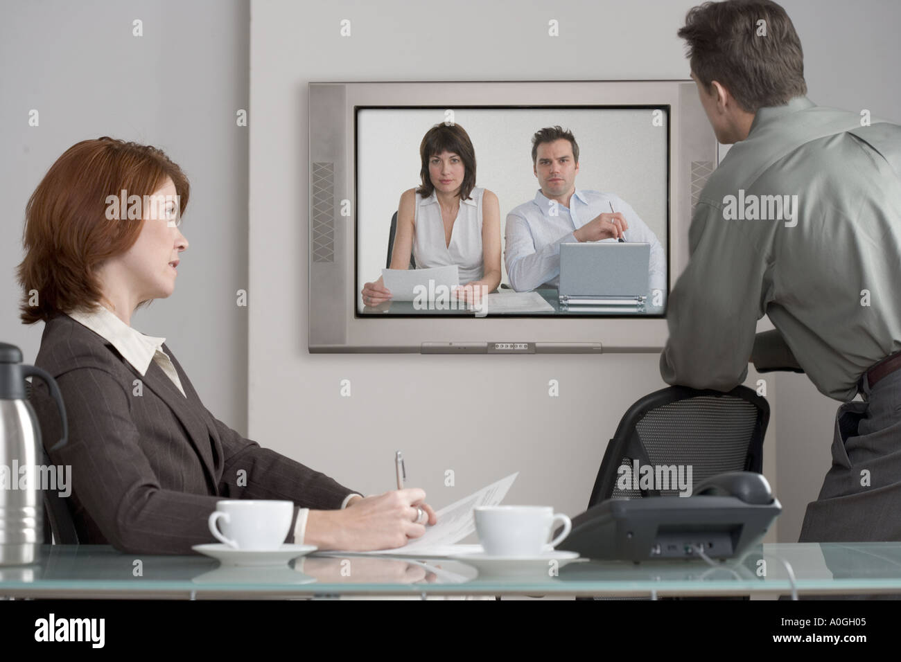 Businesspeople in videoconference - Stock Image