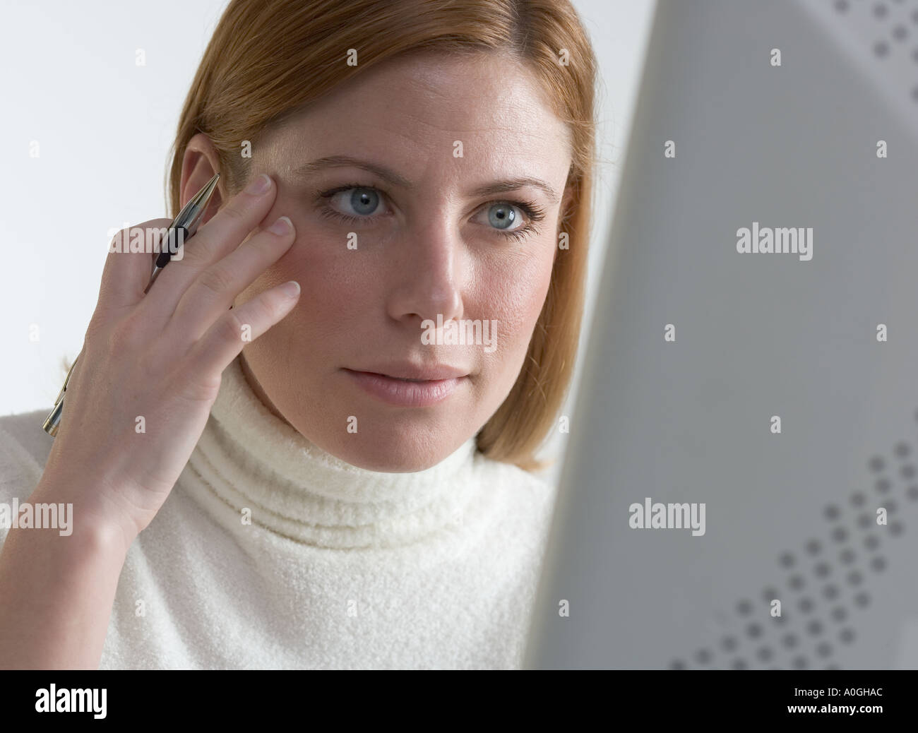 Woman focused on her computer - Stock Image