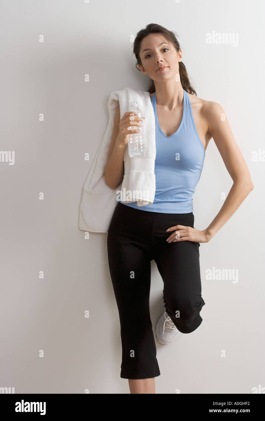 Woman in workout clothes with towel Stock Photo