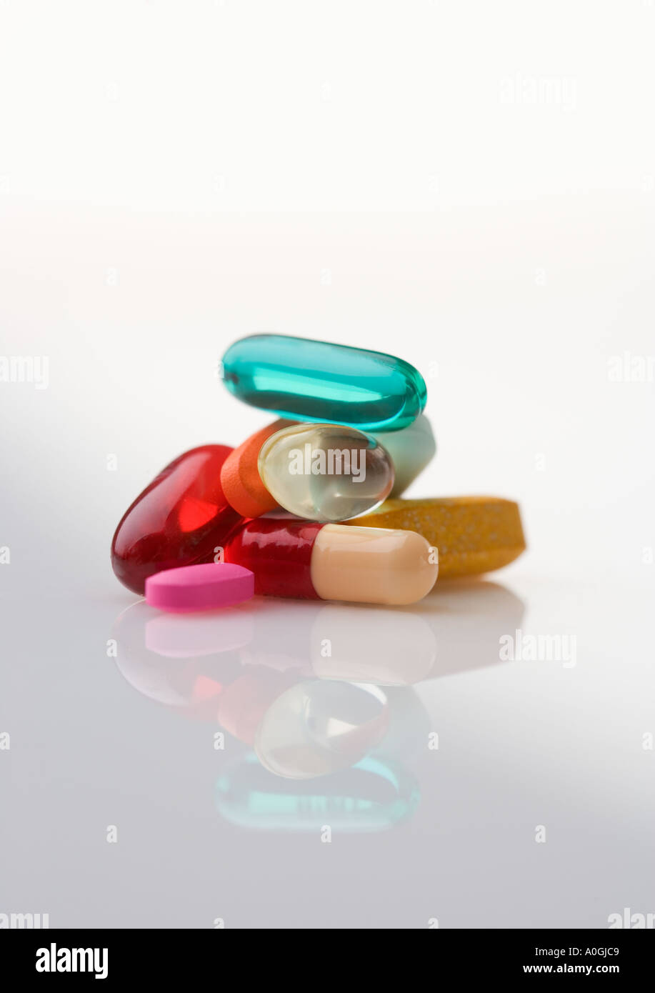 Pile of multi colored pills - Stock Image