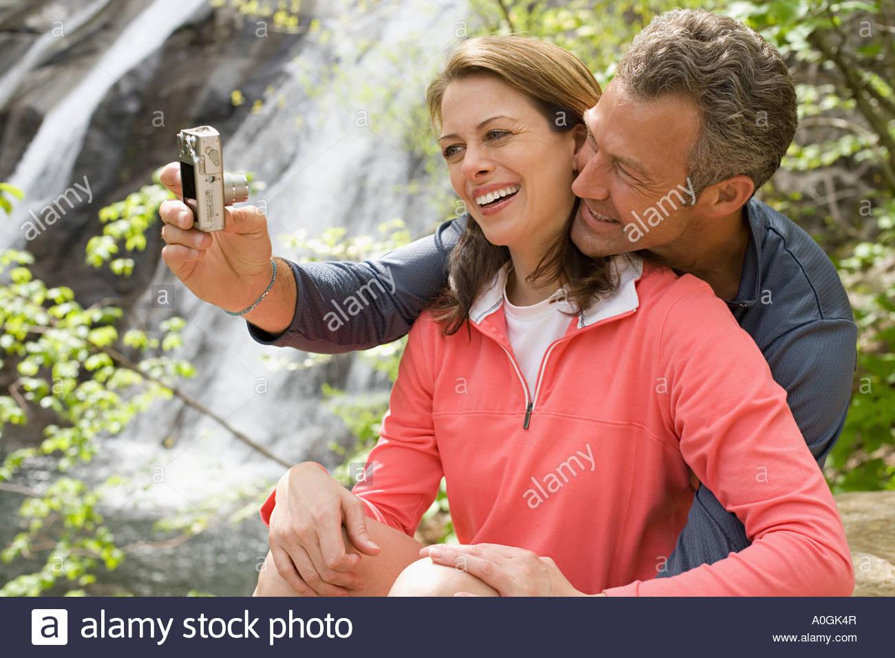 Couple taking a self portrait photograph Stock Photo
