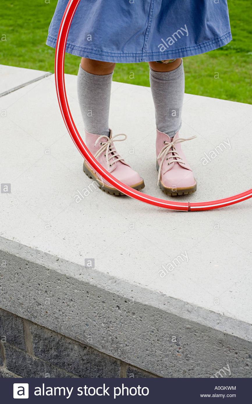 Girl holding a hula hoop Stock Photo
