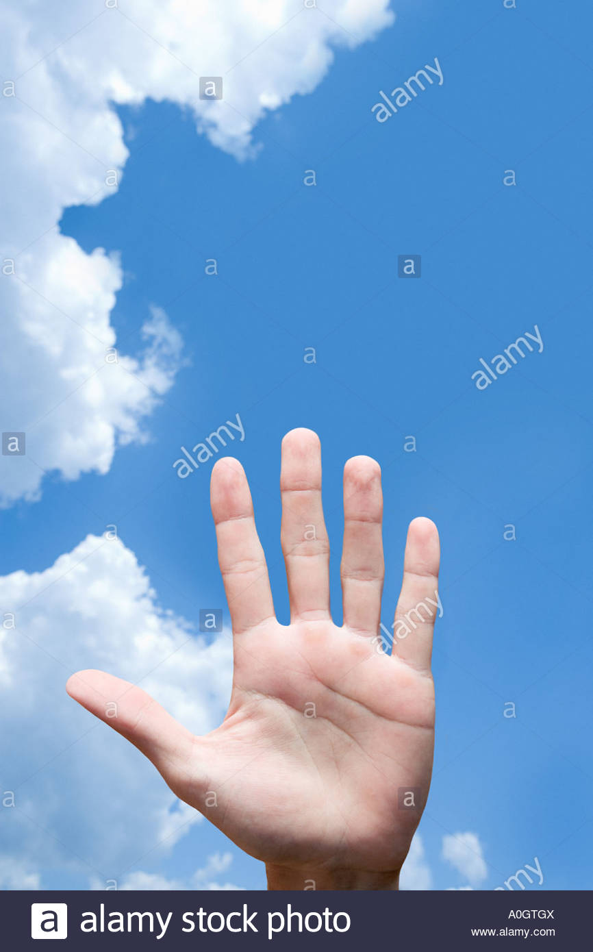 Human hand against sky - Stock Image
