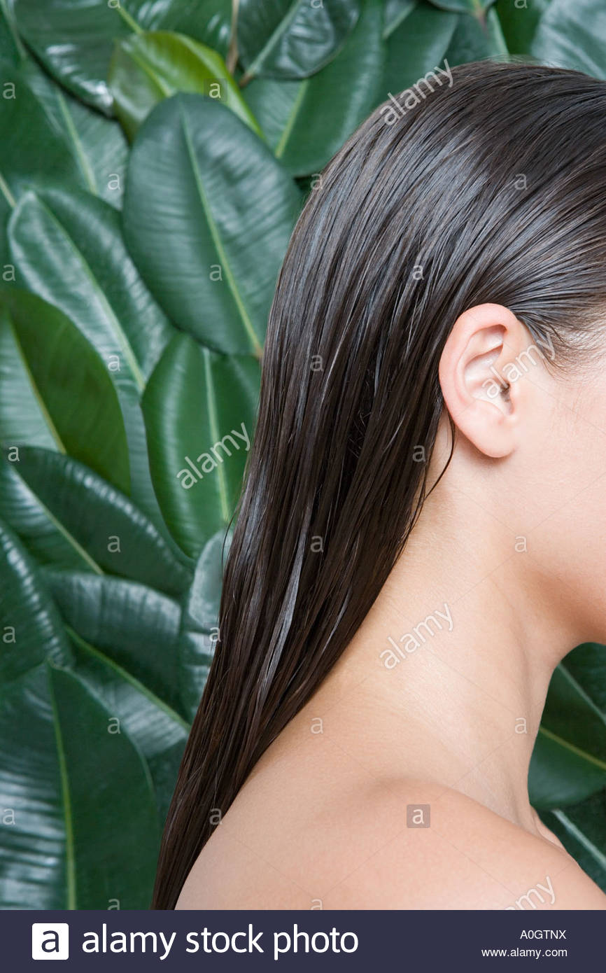 Cropped profile of a young woman - Stock Image