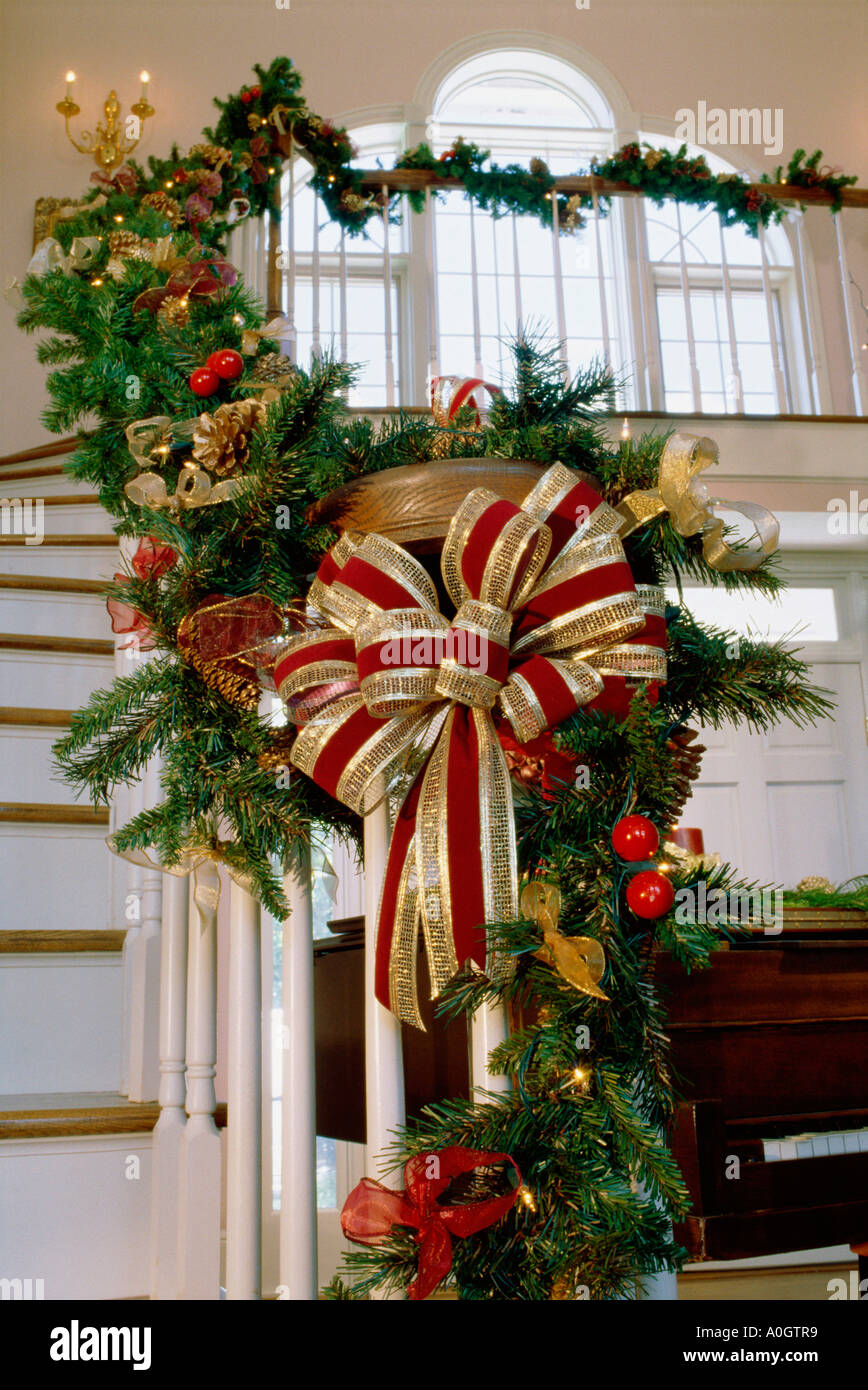 christmas decorations on a staircase banister stock image