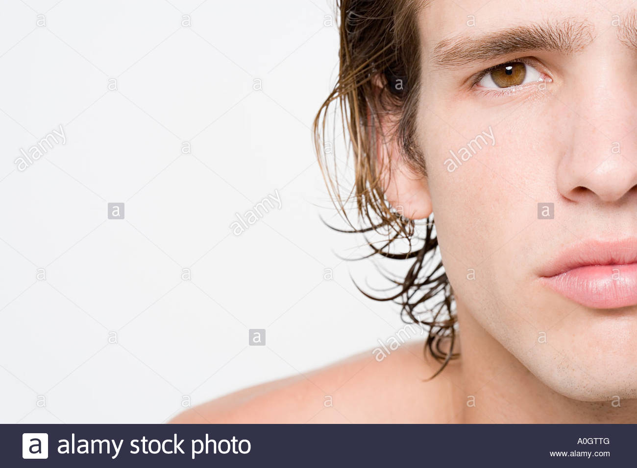 Cropped portrait of young man - Stock Image