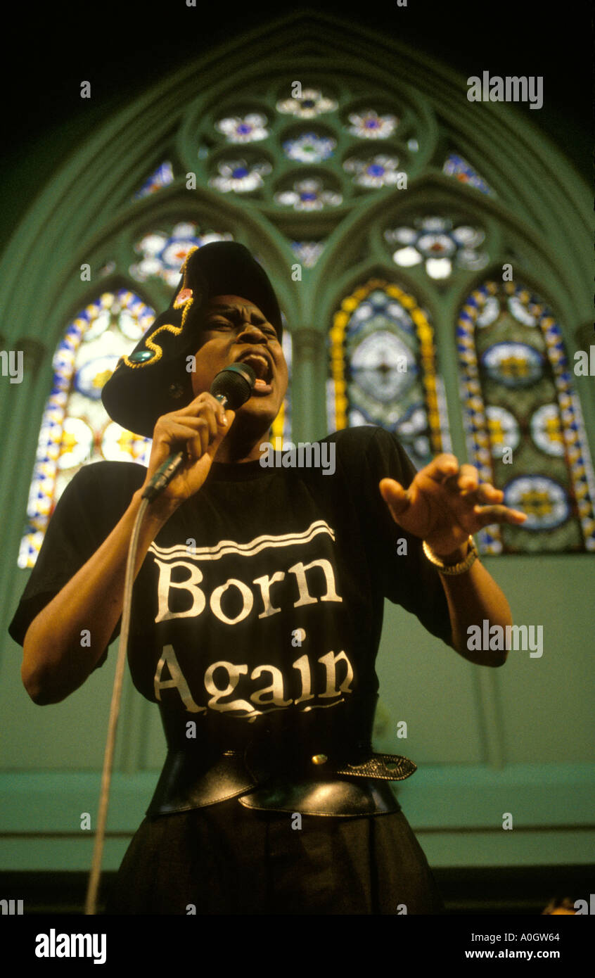 Born Again. Church of God of Prophecy a choir member performs a  solo hymn Sunday morning service London. HOMER - Stock Image