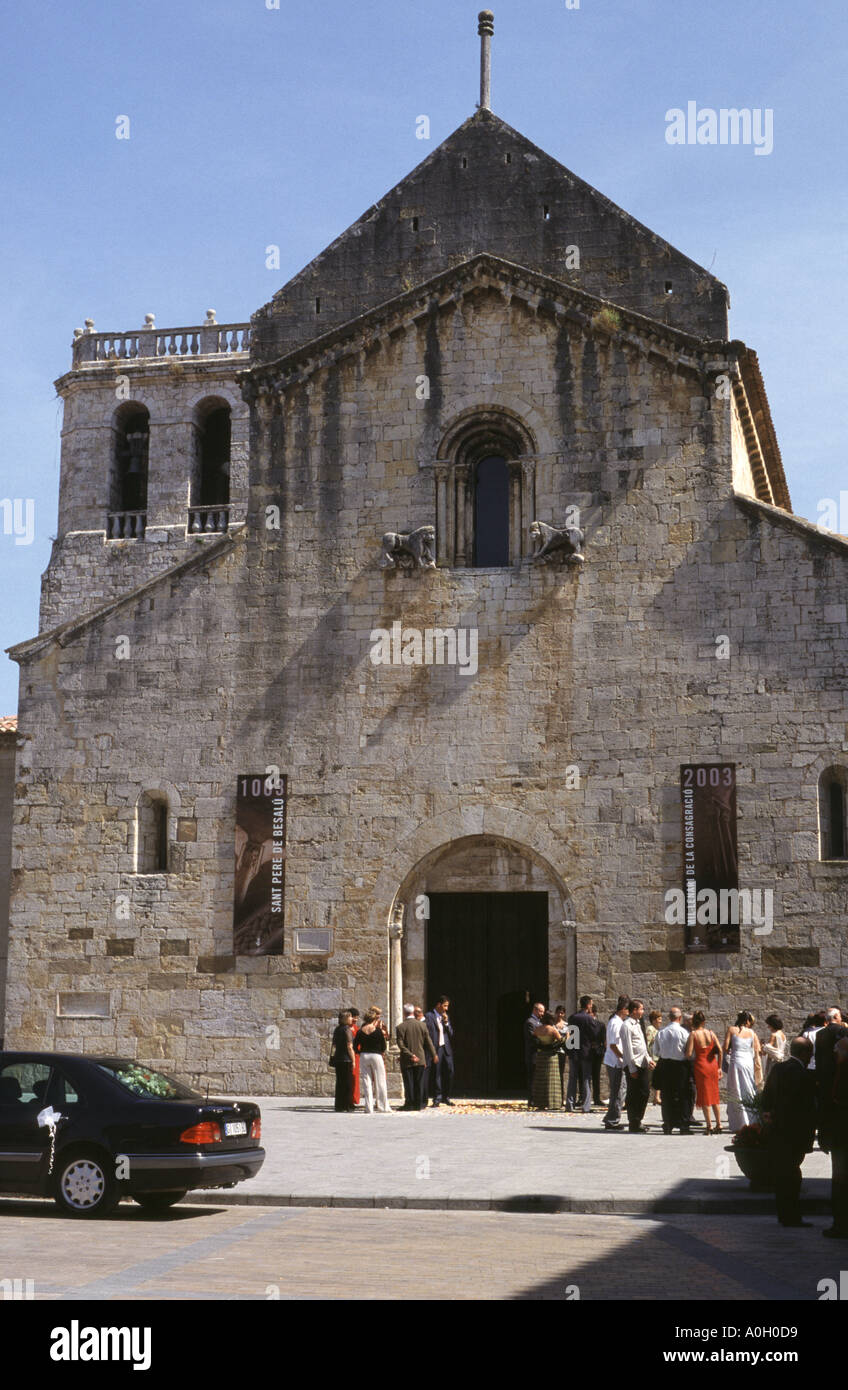 Wedding party outside the church of Sant Pere de Besalu, Costa Brava - Stock Image