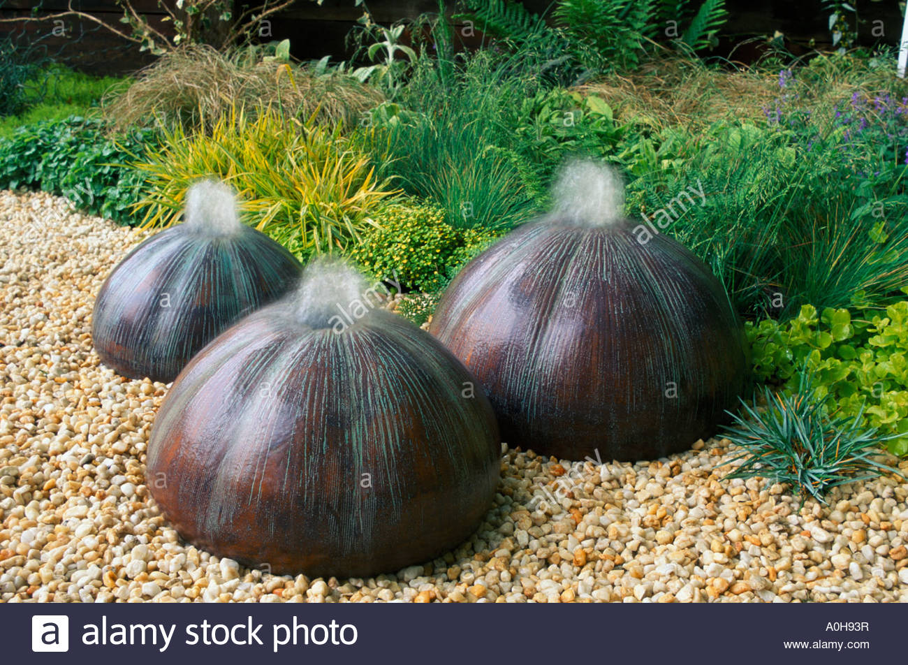 Sculptural urchin water fountain feature by Dennis Fairweather - Stock Image