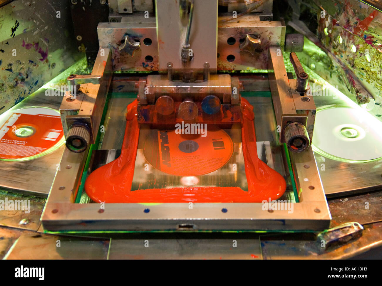 Silk screen label printing of CDs and DVDs - Stock Image